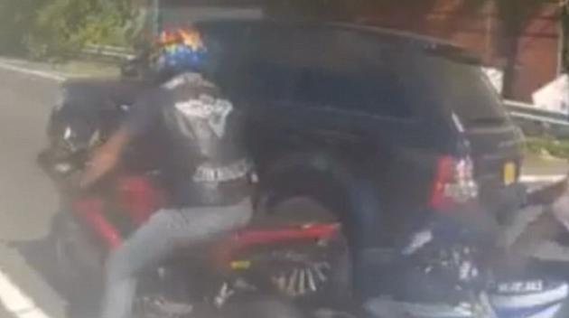 Cop Attacking SUV